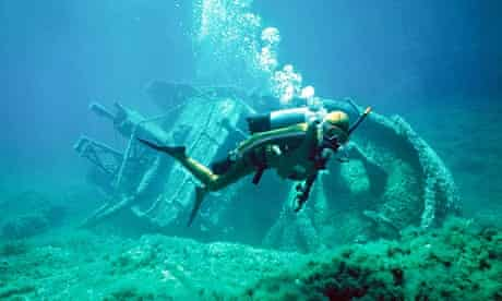 scuba diver with shipwreck underwater in Gozo Malta. Image shot 2001. Exact date unknown.