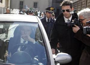 Florence Mayor and Italian center-left Democratic Party leader Matteo Renzi drives away as he is chased by reporters following a meeting with Premier Enrico Letta at Chigi Palace government office, in Rome, Wednesday, Feb. 12, 2014.