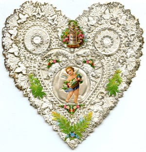 A heart Valentine featuring silver lace and a picture of Cupid, from the late 1850s. Victorian Valentines were sent anonymously and often carried no message to the recipient - it was expected that the Valentine itself would be message enough