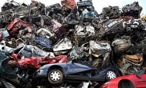 piles of crushed scrapped cars