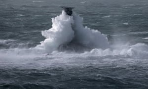 Storm waves crash over the Longships Lighthouse just off Lands End in Cornwall.
