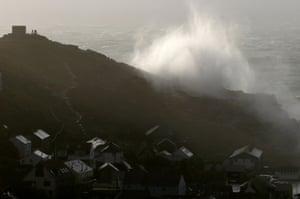 Storm waves crash over cliffs at Sennen Cove near Lands End in Cornwall.