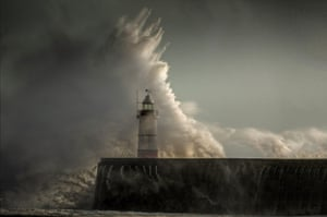 Huge waves break over the Newhaven Lighthouse on the south coast.