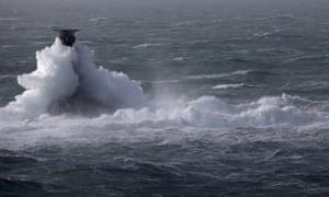 Storm waves crash over the Longships Lighthouse just off Lands End on February 12.
