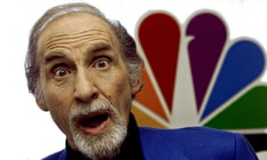 Entertainer Sid Caesar jokes with photographers