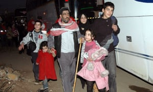 A family being evacuated from Homs in Syria as diplomats grapple with a UN security council resolution to deliver humanitarian relief.