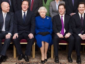 The Queen Elizabeth sits flanked by David Cameron and Nick Clegg in 2012.