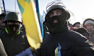 Protesters from far-right party Svoboda listen to a speech by leader Oleg Tiagnybok in Kiev, Ukraine