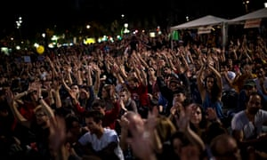 Protesters to mark the anniversary of the beginning of the 'Indignados' movement in Barcelona, Spain