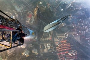 Vadim Makhorov takes photos from a cage attached to a crane above the Shanghai tower.