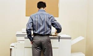man using photocopying machine