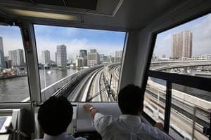 Top 10 trains: Tokyo commuters ride in a train across the Rainbow Bridge