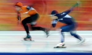 Michel Mulder of the Netherlands (left) won gold in the men's 500m speed skating