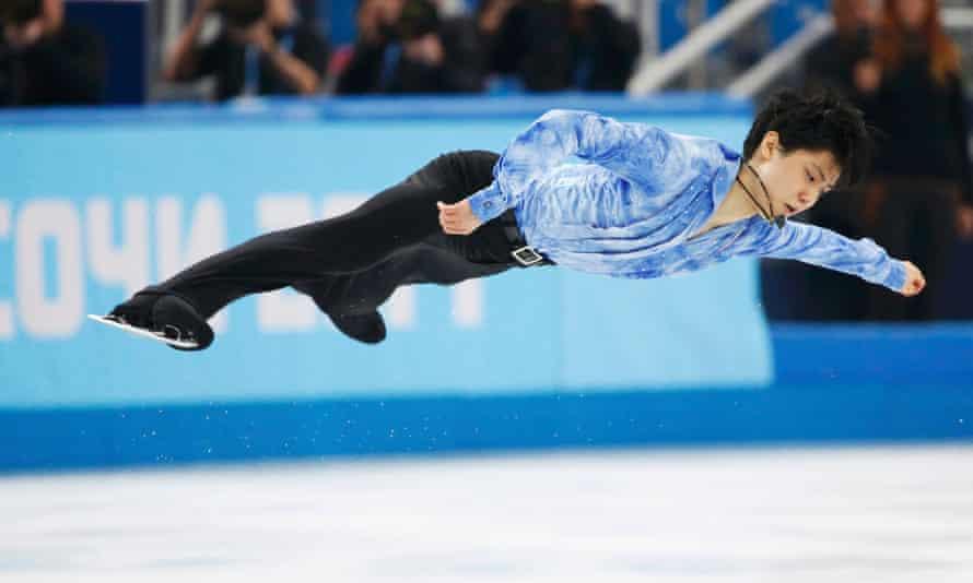Japan's Yuzuru Hanyu competes during the figure skating men's short program at the Sochi 2014 Winter Olympics.