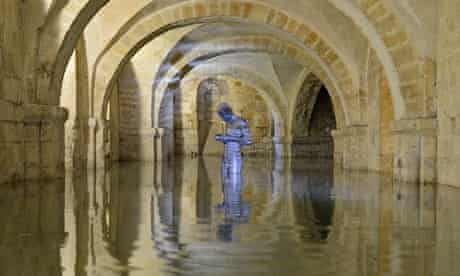 Winchester Cathedral's crypt, with Antony Gormley's statue Sound II