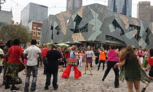 Crowds gather at Federation Square, Melbourne, Australia for One Billion Rising.