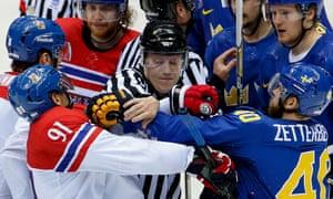 A linesman breaks up a scuffle between the Czech Republic forward Martin Erat, No91, and Sweden's Henrik Zetterberg at the 2014 Winter Olympics.