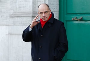 Italy's Prime Minister Enrico Letta gestures as he leaves his house in downtown Rome February 14, 2014.
