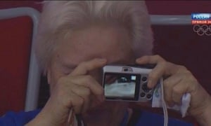 A fan at the Sochi Winter Olympics struggles with their camera.