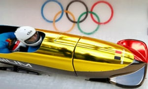 Belgium's pilot Elfje Willemsen speeds down the track during a two-women bobsleigh training session at the 2014 Sochi Winter Olympics.