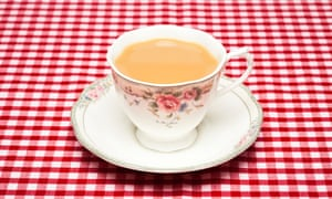 Teacup, red tablecloth