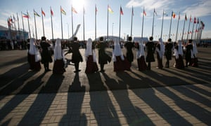 Performers dance in front of the Olympic cauldron at the Olympic Park during the Sochi 2014 Winter Olympics Games.