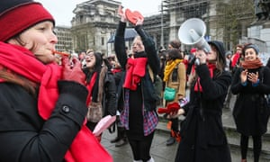 Women dance during the event in Brussels, Belgium.