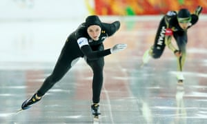 Heather Richardson of the USA  competes with Nao Kodaira of Japan in the controversial Under Armour suit during the 1000m women's speed skating event.
