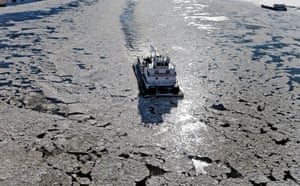 A tugboat makes its way up the icy waters of the Mississippi River on Tuesday, Jan. 7, 2014, in St. Louis.