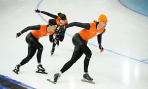 Ronald Mulder of the Netherlands, right, Jan Smeekens, left, and Laurine van Riessen, rear, practice at the Adler Arena.