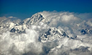 Mount Everest rises 8,848m through the clouds