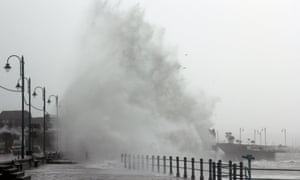 Huge wave hits the shore during high tide in Penzance.