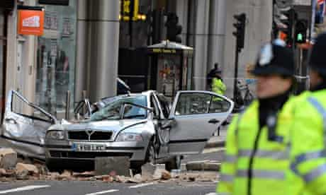 Car crushed by parts of building in central London