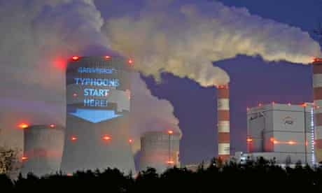 A slogan is projected by Greenpeace activists on a cooling tower of Belchatow Power Station