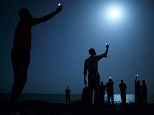Signal by John Stanmeyer is the World Press Photo of the Year 2013