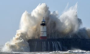 Newhaven lighthouse is battered by waves as high winds from the lastest winter storm continue in Newhaven, Sussex.