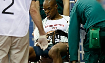 James Dasaolu is wheeled out of the Birmingham Indoor Arena with a suspected thigh strain.