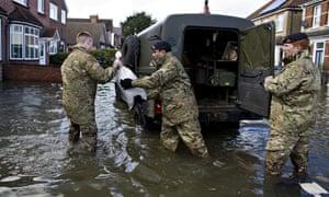 Soldiers distribute sandbags in Surrey.