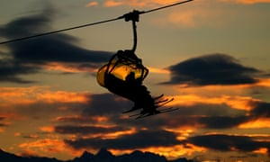 A ski lift carries skiers up the mountain on day three.