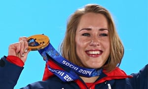 Lizzy Yarnold celebrates on the podium with her Winter Olympic gold medal