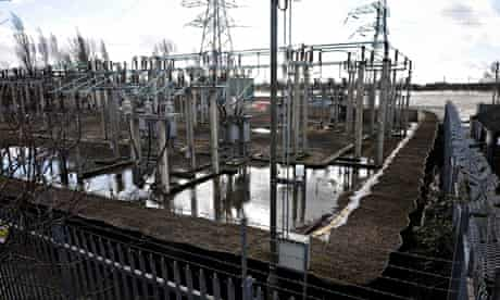Sandbags around an electricity substation close to the flooded river Severn in Gloucester