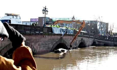 Engineers work to clear debris from the river Severn at Worcester bridge