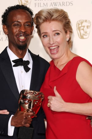 Barkhad Abdi who won the award for Best Supporting Actor for the film 'Captain Phillips' with presenter Emma Thompson