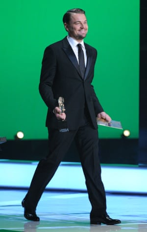 Leonardo Di Caprio heads on stage to present an award.