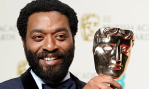Chiwetel Ejiofor poses in the press room after winning the Best Leading Actor Bafta for his performance in 12 Years A Slave