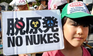 """A girl holds a """"no nukes"""" placard during an anti-nuclear demonstration in Tokyo on September 11, 2011. Japan on September 11 marked six months since the March earthquake and tsunami with ceremonies to mourn the dead and anti-nuclear rallies as the crisis continued at the crippled nuclear power plant in Fukushima.    AFP PHOTO / Toru YAMANAKA (Photo credit should read TORU YAMANAKA/AFP/Getty Images)"""