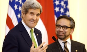 US Secretary of State John Kerry gestures during a news conference with Indonesian foreign minister Marty Natalegawa in Jakarta on Monday.