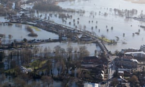 Flood water surrounds homes in Chertsey, Surrey, as Royal Engineers were now being tasked to carry out a high-speed assessment of damage to the UK's flood defence infrastructure.