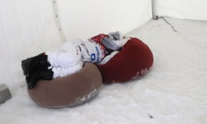 Poland's Mateusz Ligocki rests after the seeding runs were cancelled due to fog during the men's snowboard cross at the 2014 Winter Olympics.