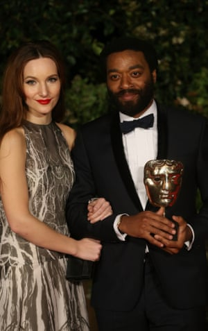 Chiwetel Ejiofor and Sari Mercer attend an official dinner party.